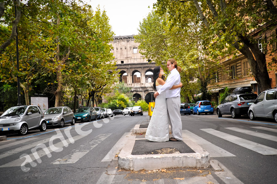 Couple kissing in the streets of Rome Italy with the Roman Coliseum in background