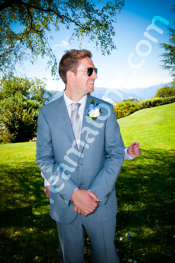 Groom waits for the bride in an outdoor wedding