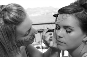 bride getting ready in black and white picture