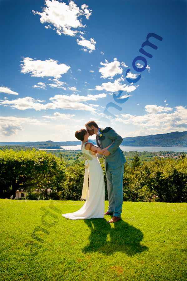 Bride & Groom kissing during a matrimony over Lago Maggiore near Stresa. Lake Maggiore Wedding Photographer.