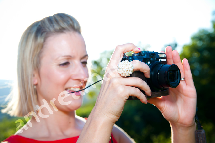 Photographer taking a digital picture at a matrimony.