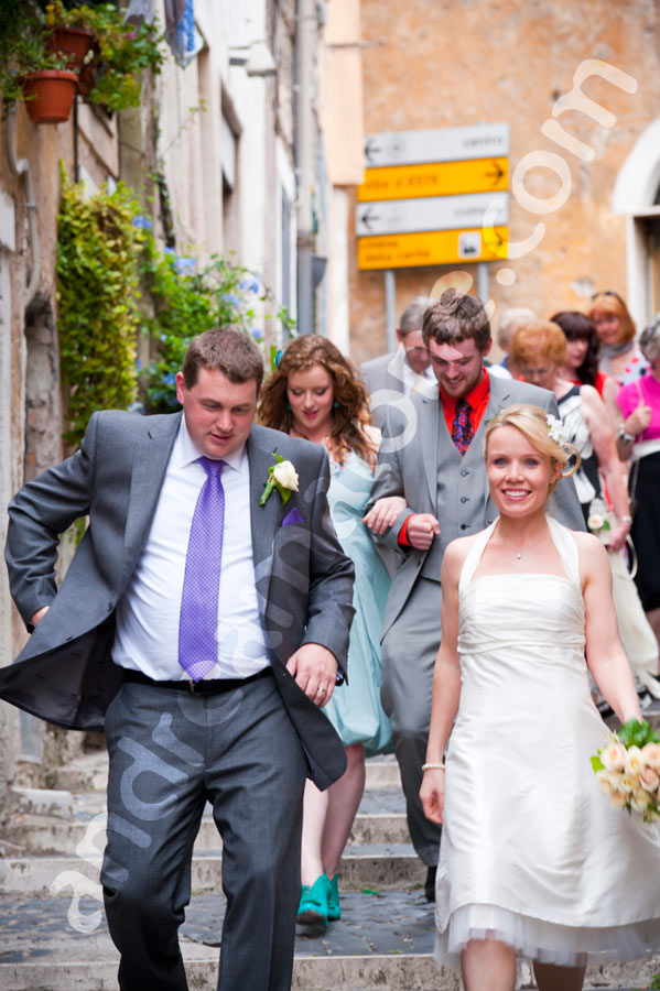 The wedding party walking in Tivoli Italy