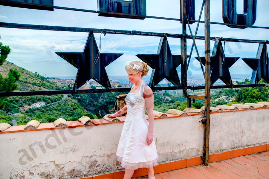 Bride walking with her dress on the rooftop building