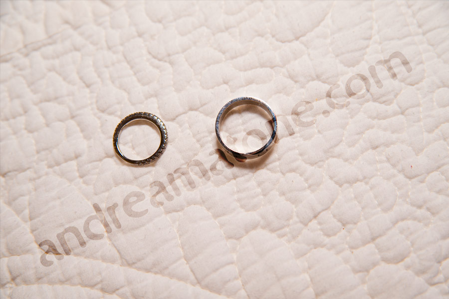 Wedding rings on the bed