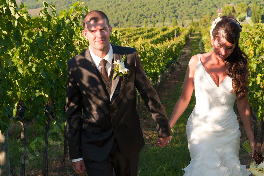Couple walking together in a vineyard in Tuscany