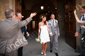 Couple exiting the City Town Hall after wedding in Sala Rossa Piazza della Signoria Florence Tuscany Italy