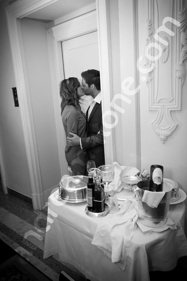 Kissing in black and white inside Hotel Regis