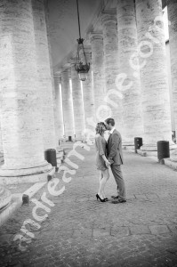 Couple kissing under collonade at the Vatican in Rome Italy Saint Peter's