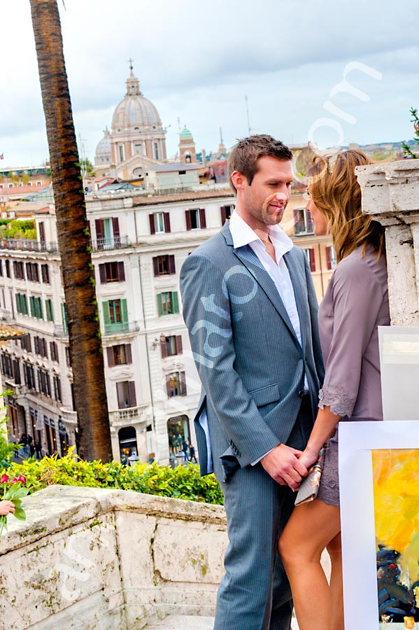 Romantic engagement at Piazza di Spagna overlooking the city of Rome.