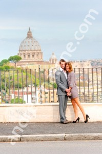 Couple in photography in front of Saint Peter's Dome in Rome Italy