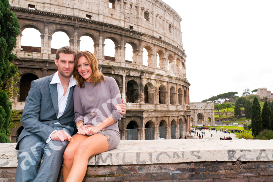 Together in front of the Colosseum.
