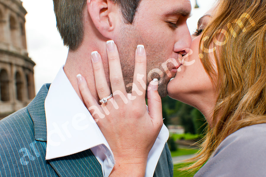 Kissing during engagement session with ring close up