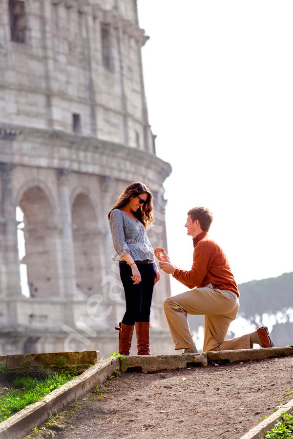 Wedding Vows proposals in Rome. Picture taken in front of the Roman Colosseum in Rome Italy.