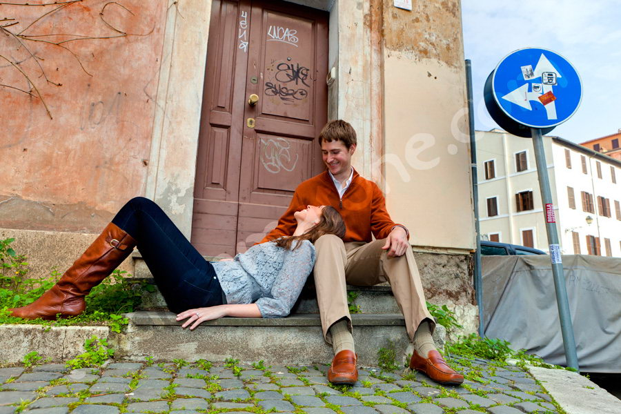 Laying down on a doorstep in the cobble like streets