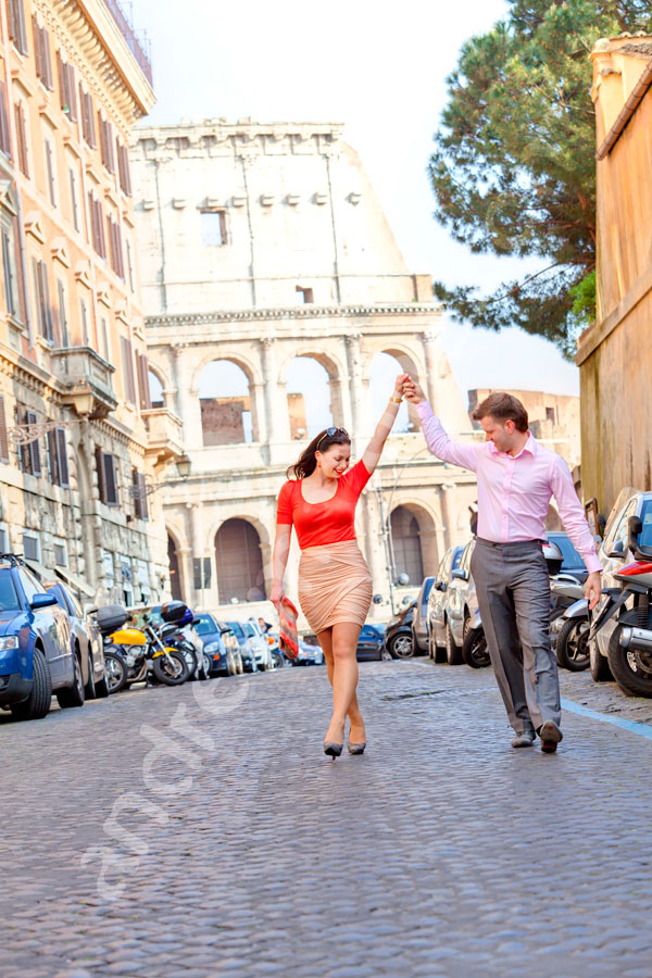 Couple in romantic dance poses walking away from the Colosseum