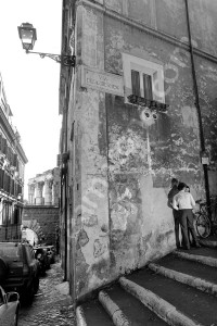 Black and white photo in the ancient old roman streets and alleyways of Rome Italy