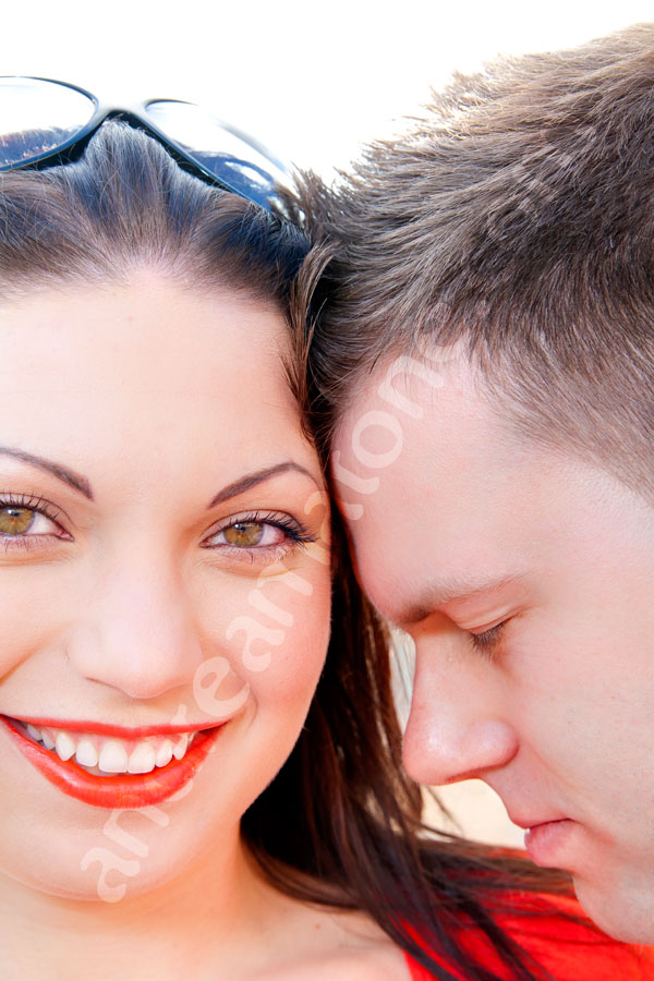 Head shot closeup photography executed of a woman and a man smiling in love