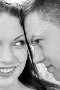 Woman and man looking at each other while photographed at close distance in black and white