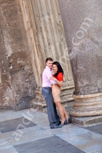Couple holding each other underneath the colonnade of the Roman Pantheon in Rome Italy