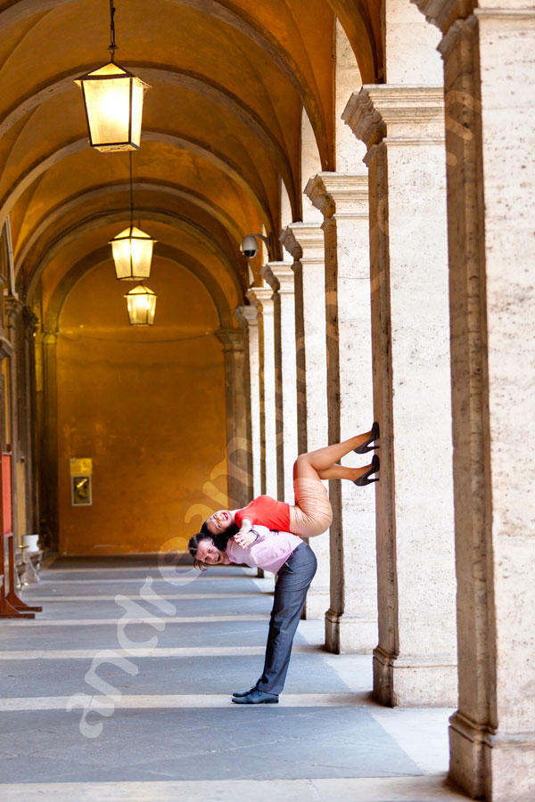 Couple doing acrobatics poses. Anniversary photo shoot in Rome Italy.