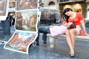 Couple relaxing in Piazza Navona in Rome