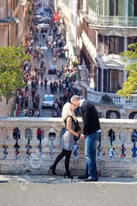 Couple romantically kissing at Piazza di Spagna in Rome Italy