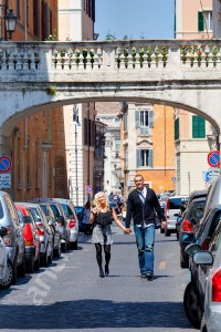 Couple walking together in the alley streets of Rome Italy