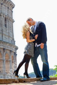 Kissing in front of the Roman Coliseum in Rome Italy