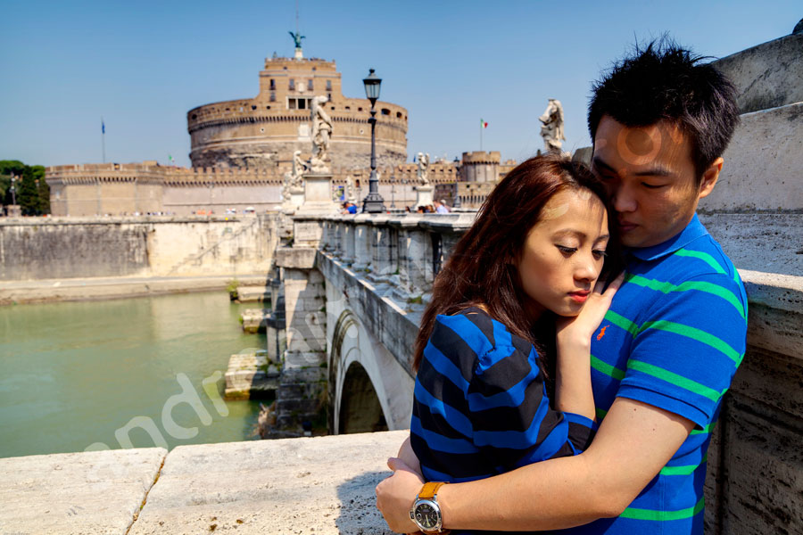 Couple close together on Castel Sant'Angelo bridge in the center