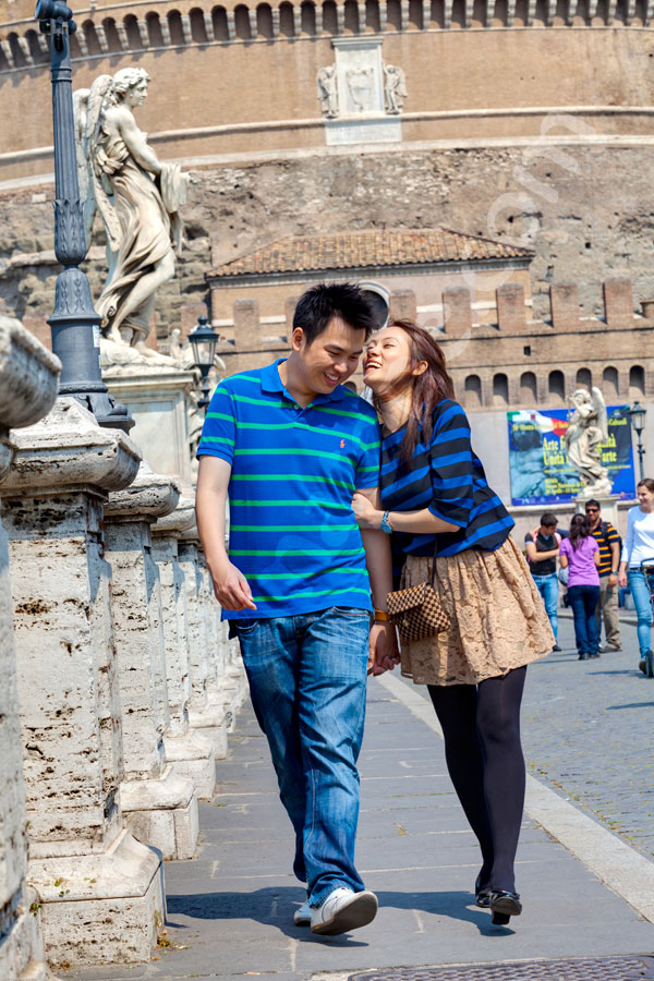 Having fun and walking talking and laughing on the bride in front of the Sant'Angelo Castle