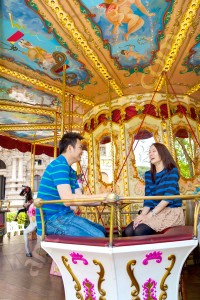 Wedding engagement couple having fun on a carousel in Rome
