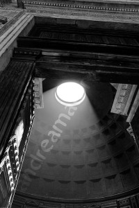 The sunlight coming from the hole in the dome of the Roman Pantheon in Rome Italy