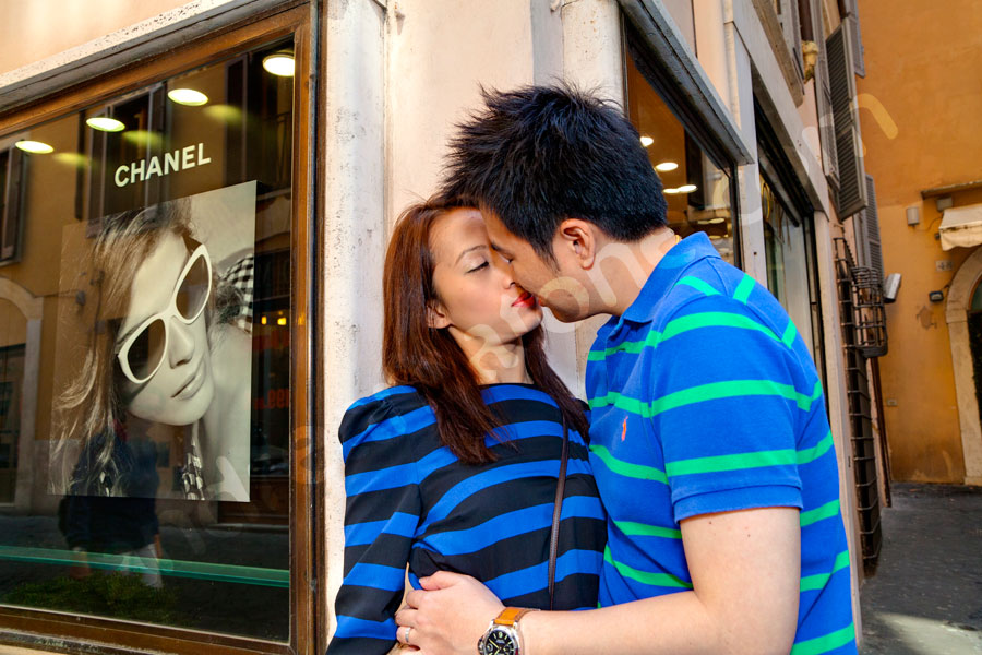 Fashion kissing in the heart of the ancient city by Chanel sign.