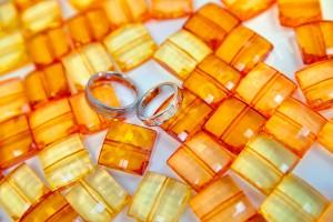 The luxurious wedding rings set on orange background