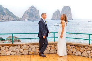 Bride and groom about to get married in Capri Italy in front of the Faraglioni at Canzone del Mare