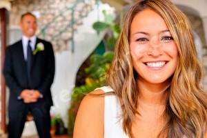 Wedding bride looking through the photographer's camera