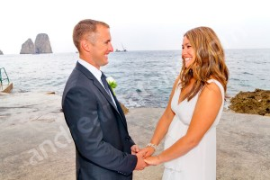 Bride and groom holding hands in Canzone del Mare on the island of Capri