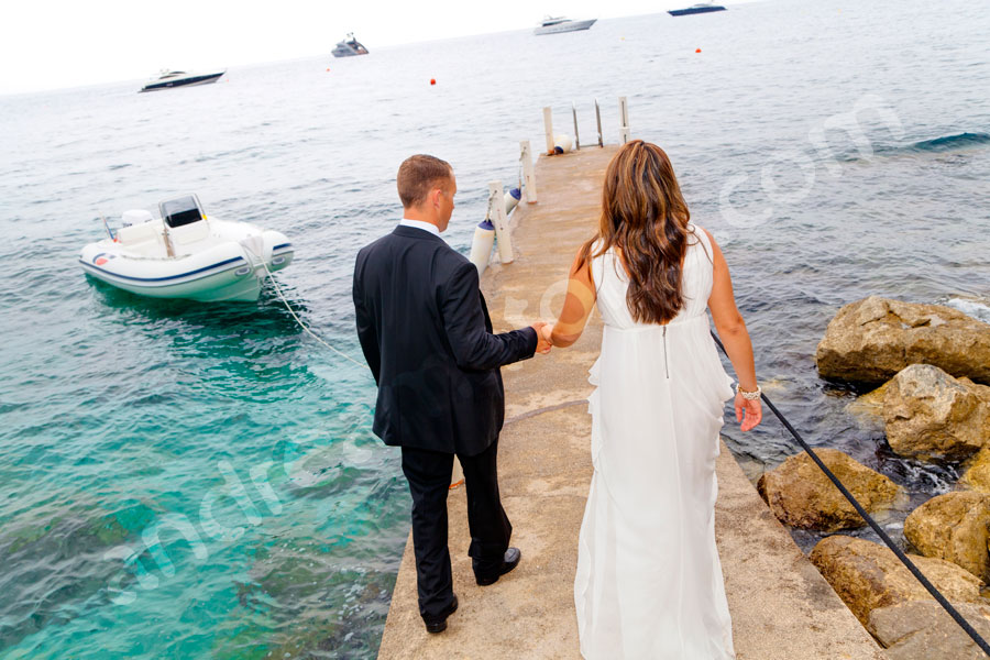 Wedding husband and wife just married on a jetty in Italian Capri