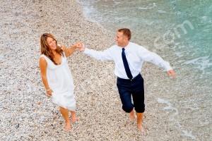 Walking on the pebble beach on the island of Capri Italy