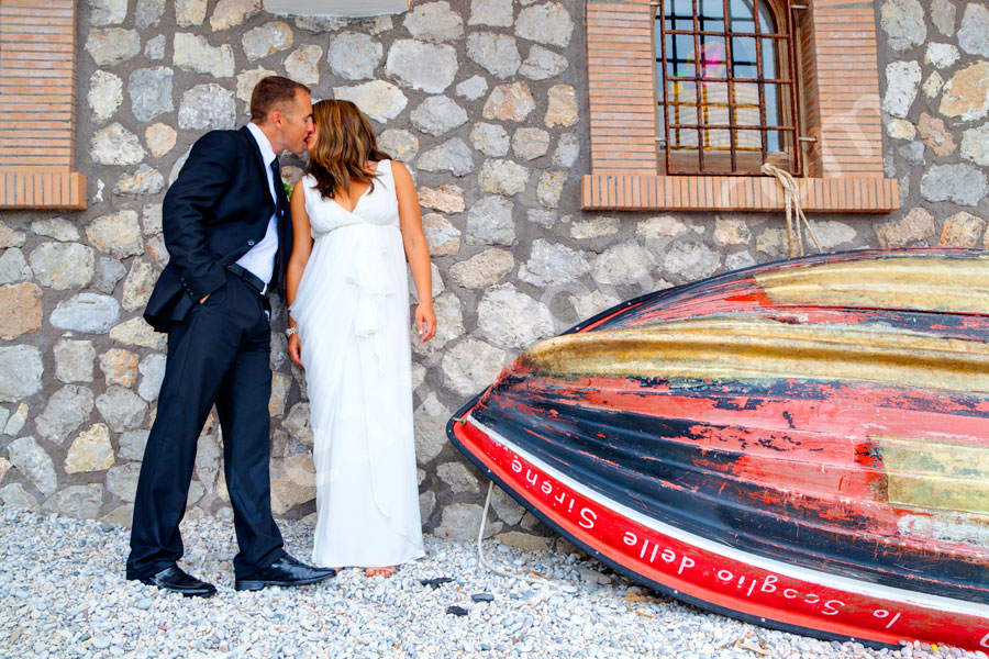 Kissing by a boat on the beach of Capri Marina Piccola