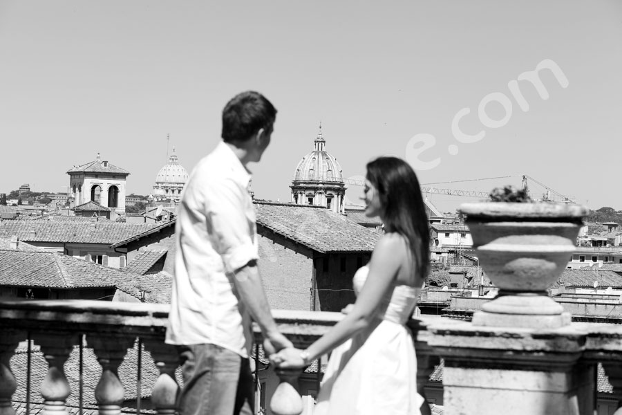 Couple in love overlooking the beautiful roman cityscape