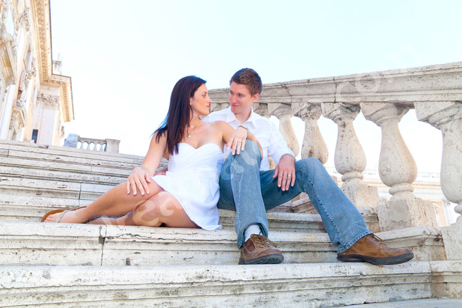 In love in Rome looking at each other on the stairs of Campidoglio