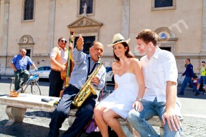 A couple having fun with a music band on Piazza Navona in Rome