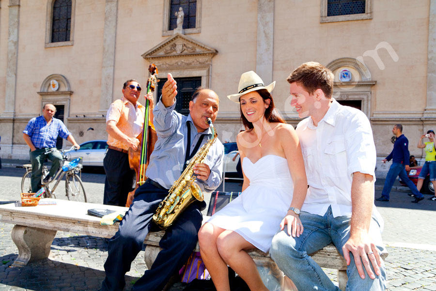 A couple having fun with a music band on Navona square