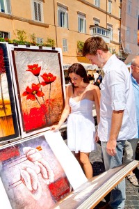 Flipping through poster pictures in Piazza Navona