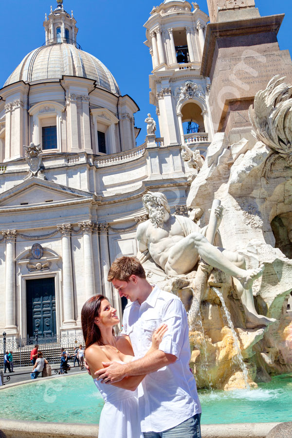 Couple photographed by the Four River Fountain in Piazza Navona