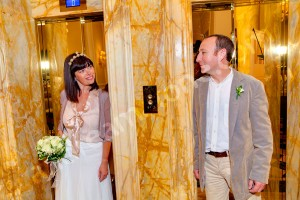 Bride and groom standing next to each other by a hotel elevator in Rome Italy
