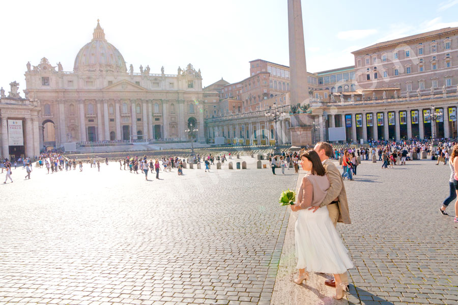 Newlyweds entering Piazza San Pietro Saint Peter's square in the Vatican