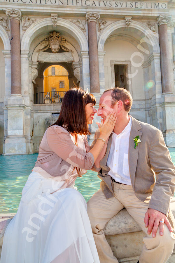 Married couple at Gianicolo water fountain in the city of Rome