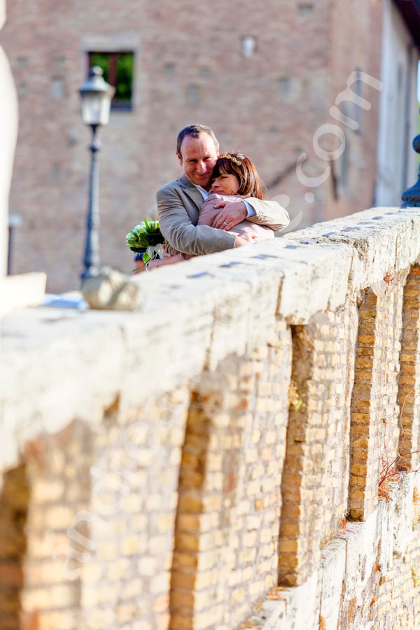 Hugging on the bridge of Tiber island in Rome